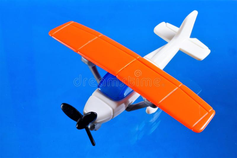 Children`s toy airplane - miniature, reduced model, collectible. The aircraft is an aircraft, consists - fuselage, wings, engine royalty free stock image