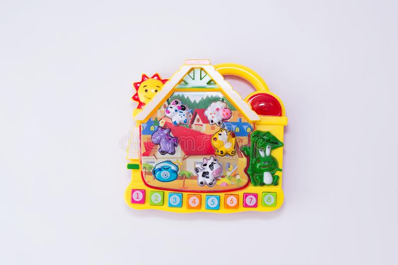 Children toy musical piano with animals and numbers look like house  on white background. educational game. Children`s toy musical piano with animals and numbers stock images