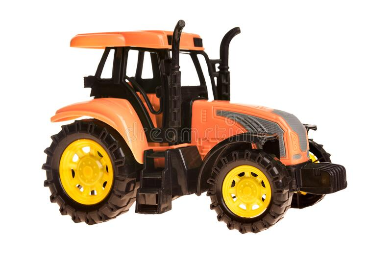 Children`s toy small green toy tractor isolated on white. Background royalty free stock images