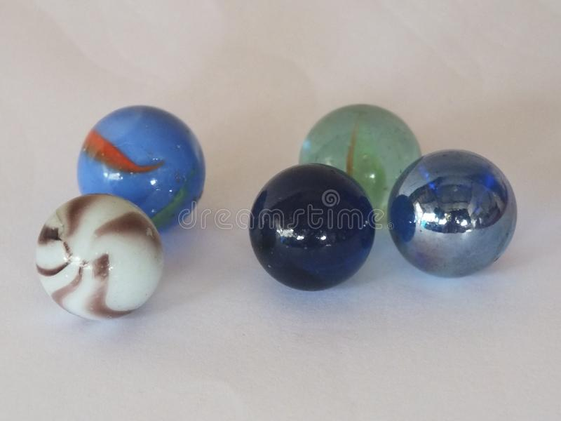 Children`s toys marbles at home stock photo