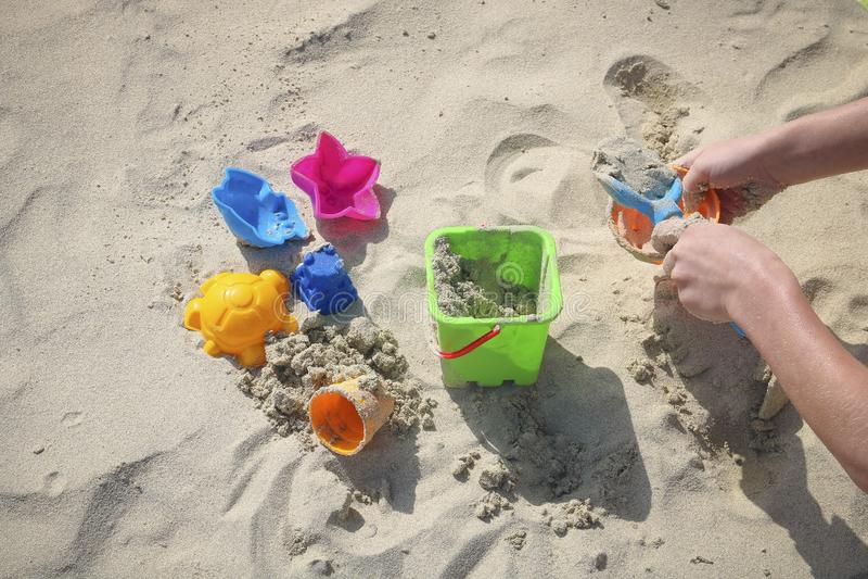 Children`s toys on the sandy beach stock image