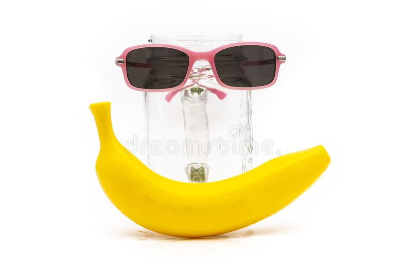Children`s toys with sunglasses and bananas isolateed white background royalty free stock photos