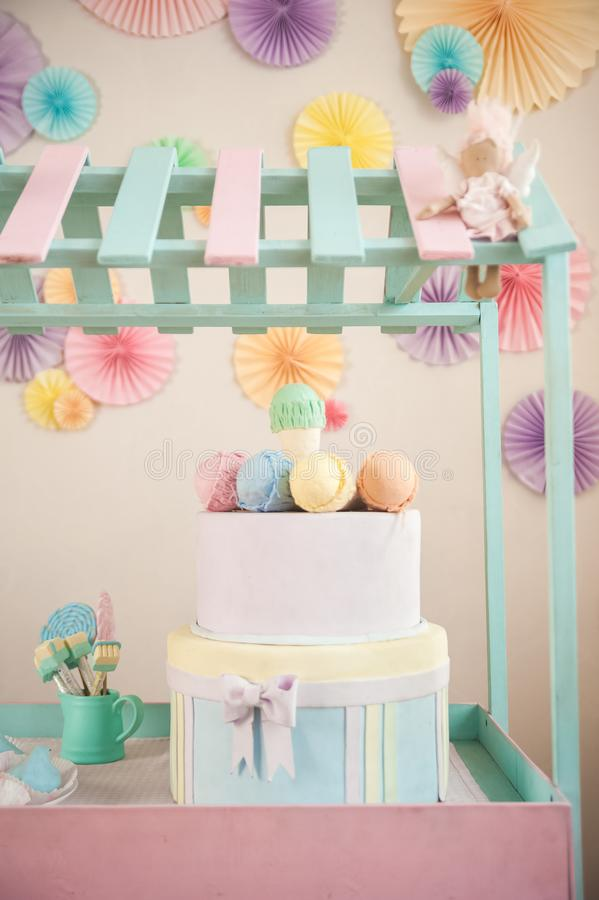 Children`s wooden and textile toys. Toy trolley with ice cream and cupcakes. Handmade textile ice cream close-up and copy space. B stock image