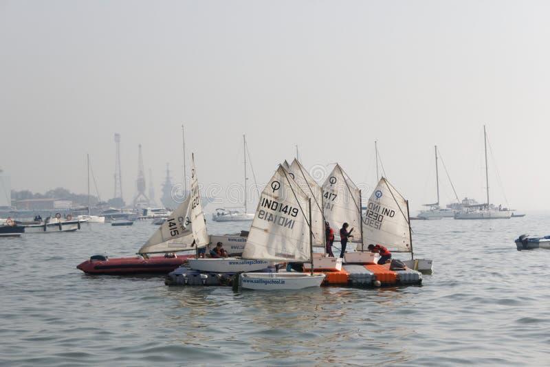 Children Sailing School, Optimist Dinghy Sail boat. The Optimist Dinghy, also known as the 'opti' or `bathtub`, is a small, single-handed sailing royalty free stock photo