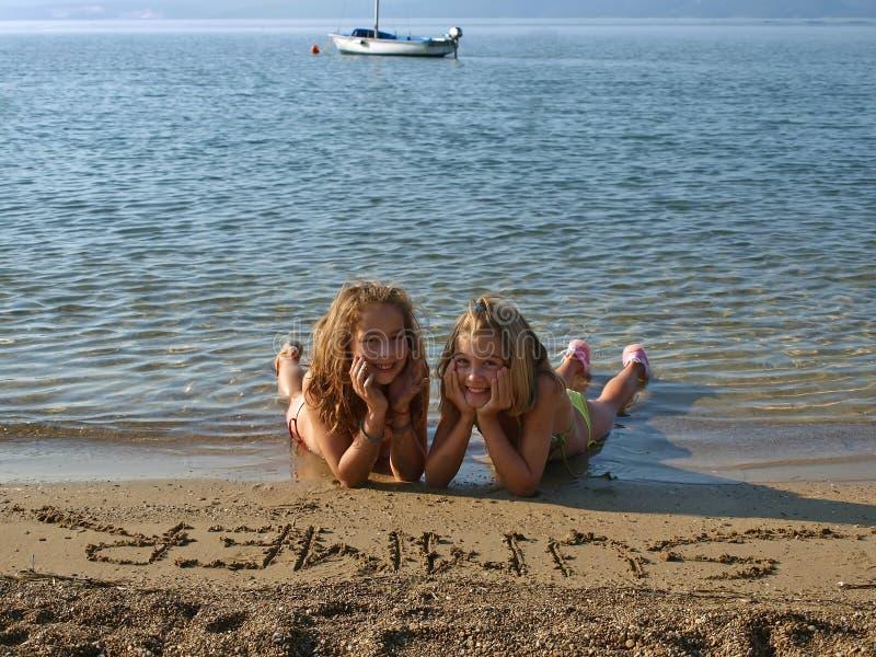 Children on sandy beach 3 royalty free stock photos