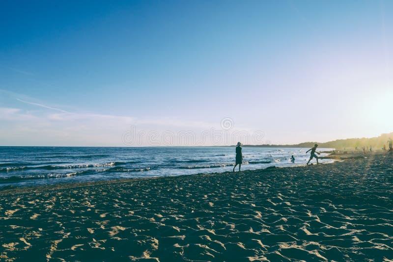Children on sandy beach royalty free stock photo