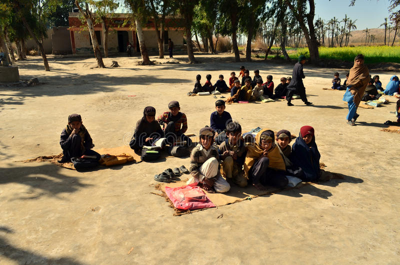 Children School on Ground!. This was the school i found in a village near Dera Ismail Khan city of Pakistan where young kids were sitting on mats to carry on royalty free stock photography