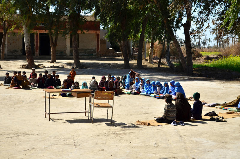 Children School on Ground!. This was the school i found in a village near Dera Ismail Khan city of Pakistan where young kids were sitting on mats to carry on royalty free stock images