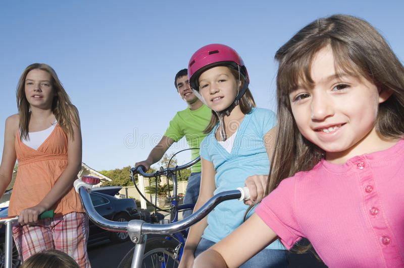 Children With Scooter And Bicycles royalty free stock photography