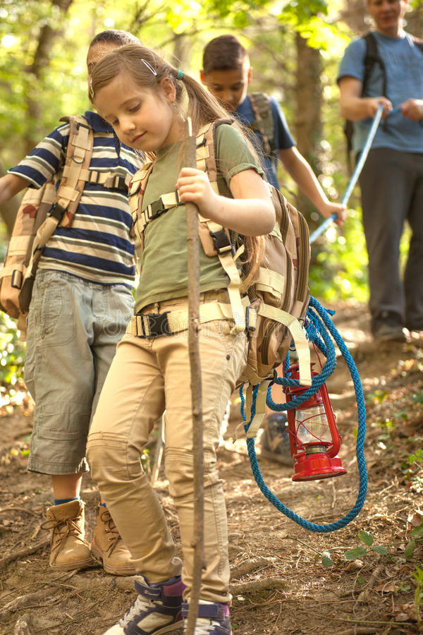 Children scouts and father explore the beautiful forest. Kids in green forest playing,concept of kids vacations and travel stock photos