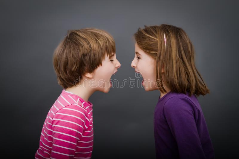 Children screaming face to face stock photo