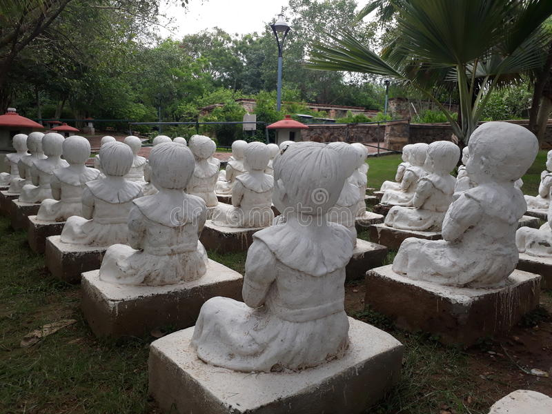 Children sculpture. A children sculpture in Garden of five senses stock photos