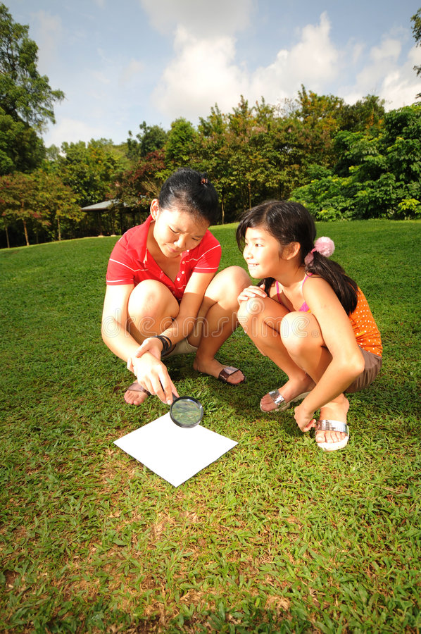 Children searching for clues royalty free stock photo
