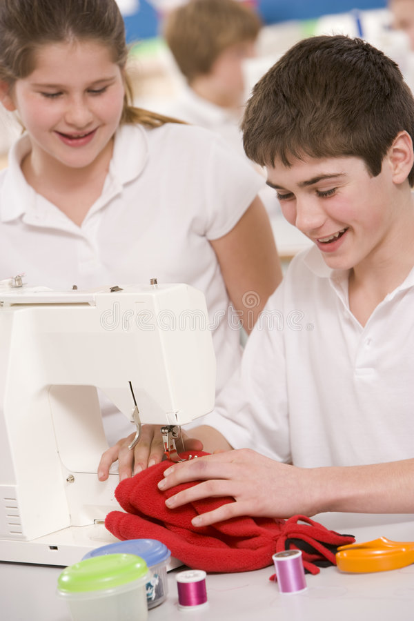 Children with sewing machine stock photos