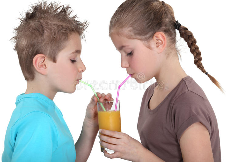 Children sharing juice stock photos