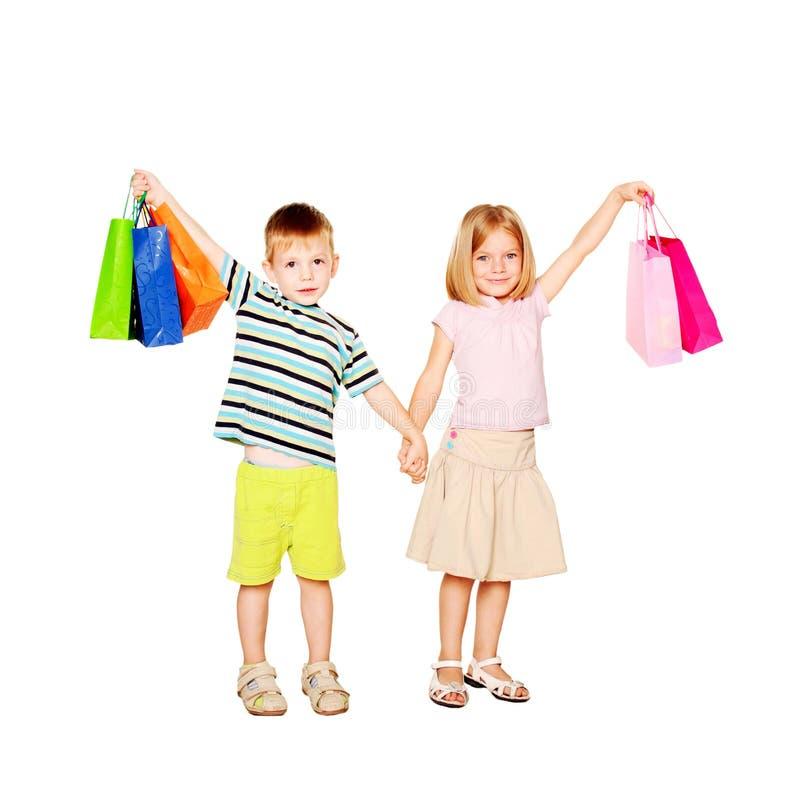 Children shopping. Isolated on white royalty free stock photos
