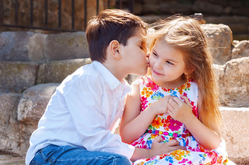Children show love and affection to each other. Brother sister k. Issing. The boy courting a girl stock photography