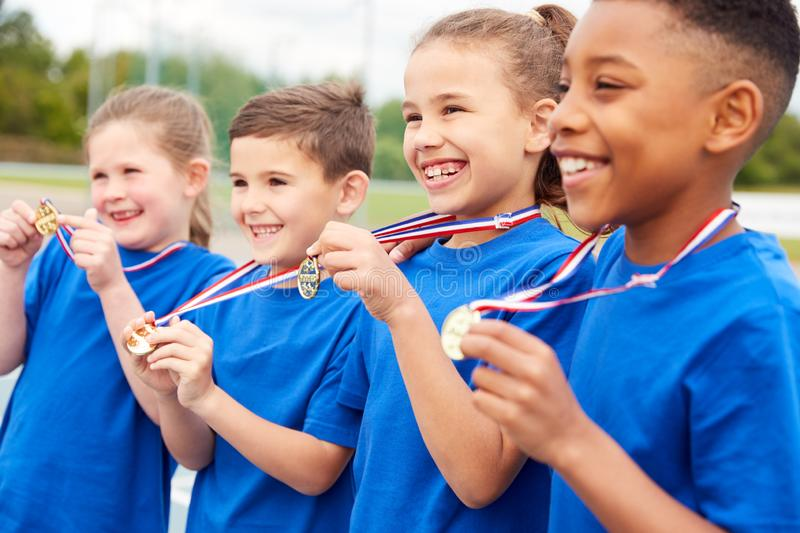 Children Showing Off Winners Medals On Sports Day royalty free stock photo
