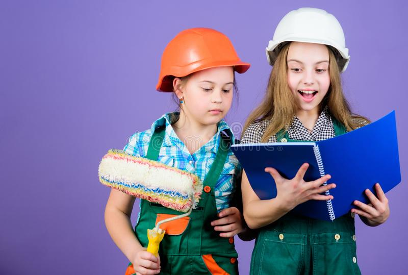 Children sisters run renovation their room. Amateur renovation. Sisters renovating home. Home improvement activities royalty free stock photos