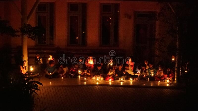 Children sitting in candlelight royalty free stock photo