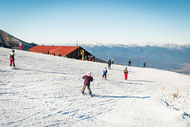 Children skiing in Bansko, Bulgaria royalty free stock image