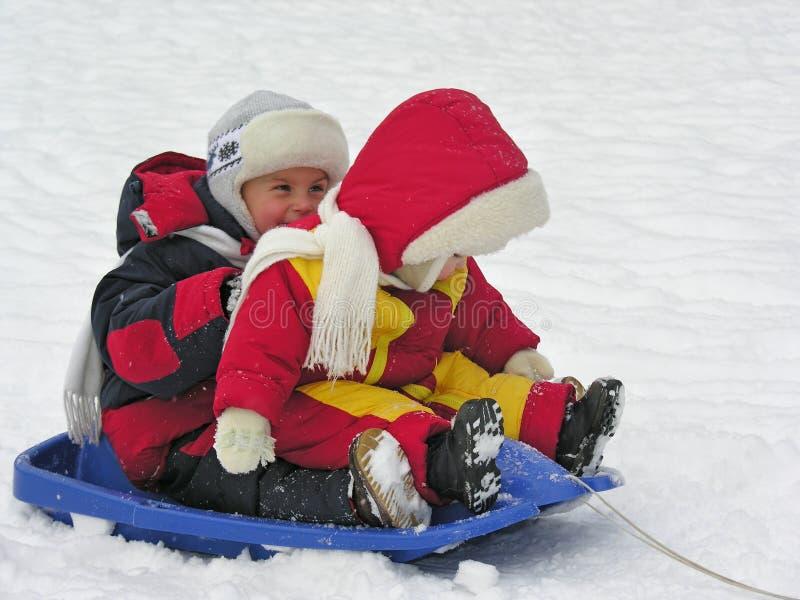 Children on sled. Children sit on sled on snow stock images