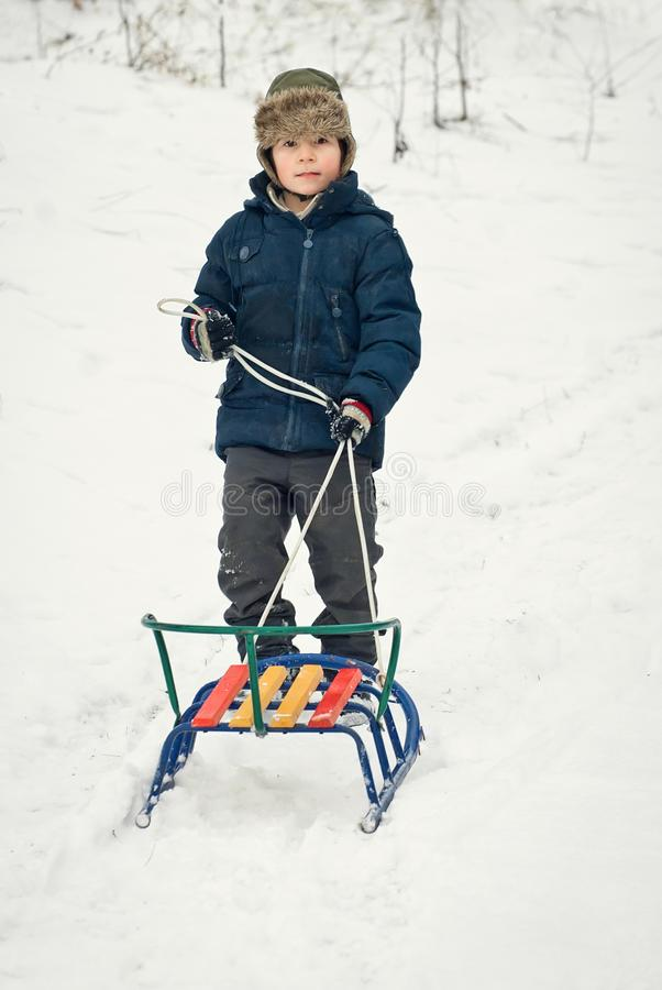 Children sled in winter in fresh air stock photo