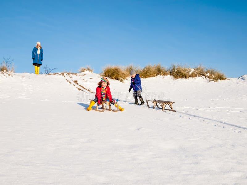 Children sledging stock image