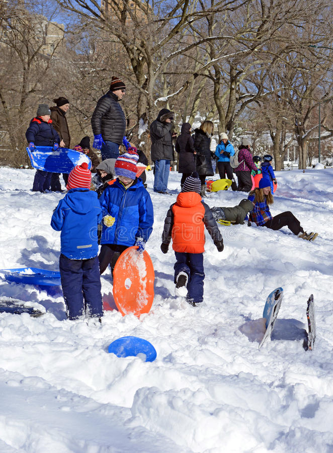 Download Children Sleigh Riding In The Snow Editorial Photography - Image: 65564092