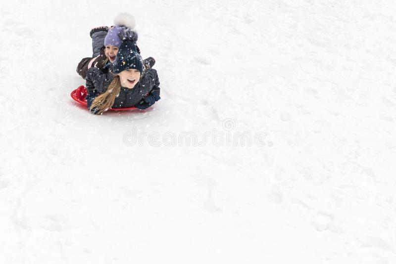 Children slide on ice-boats stock photos