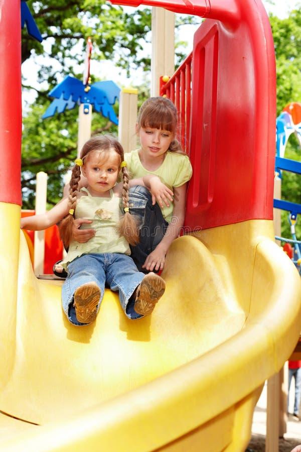 Download Children On Slide Outdoor In Park. Stock Image - Image: 14435917