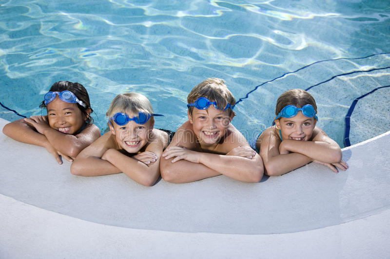Download Children Smiling At Edge Of Swimming Pool Royalty Free Stock Photography - Image: 16795627