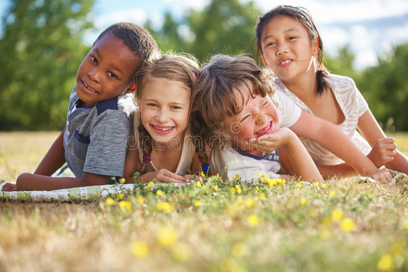 Children smiling and having fun. On the grass royalty free stock images