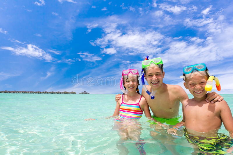 Children with snorkels in sea royalty free stock photos
