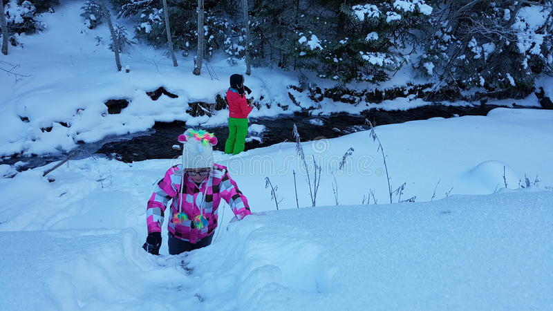 Download Children In Snow By Creek Stock Photo - Image: 83713056