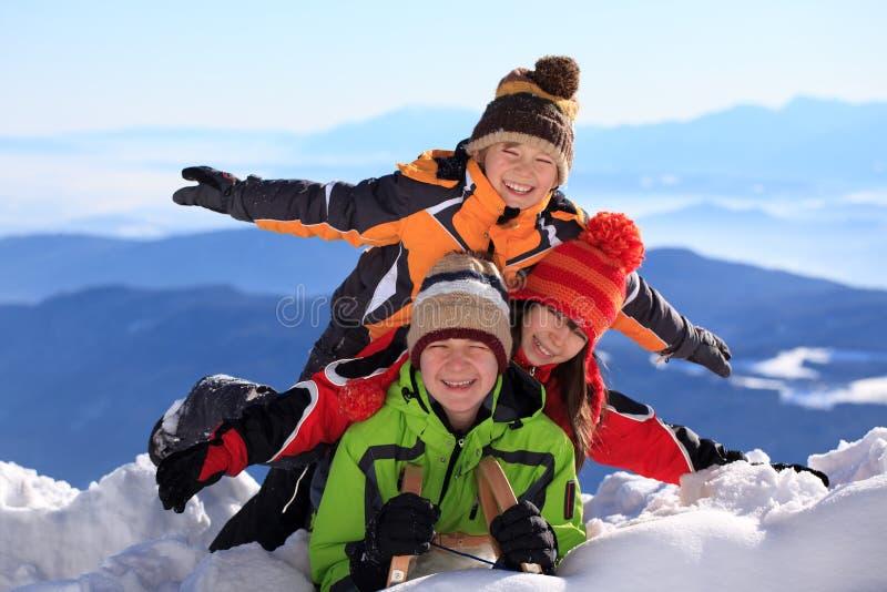 Children on snowy mountain royalty free stock photos