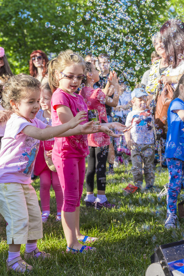 Children and soap bubbles royalty free stock photography