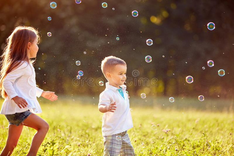 Children with soap bubbles. In nature royalty free stock images
