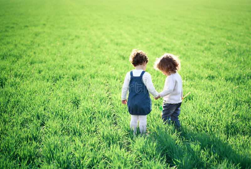 Children In Spring Field Royalty Free Stock Images