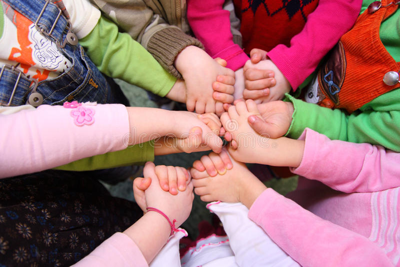 Children Stand Having Joined Hands,  Top View Stock Photo
