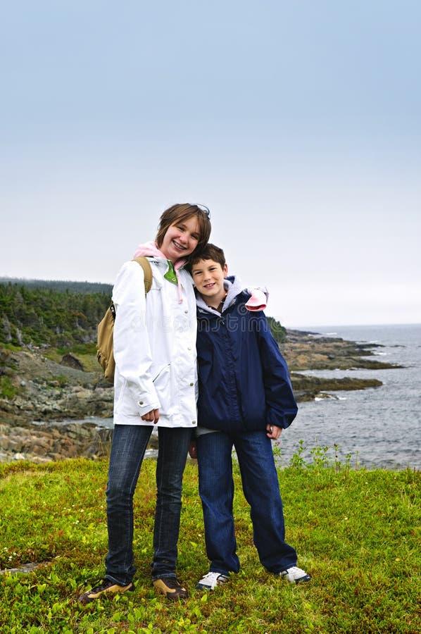 Children standing at Atlantic coast in Newfoundlan stock photography