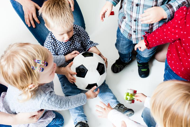 Children stretch to the ball royalty free stock photo