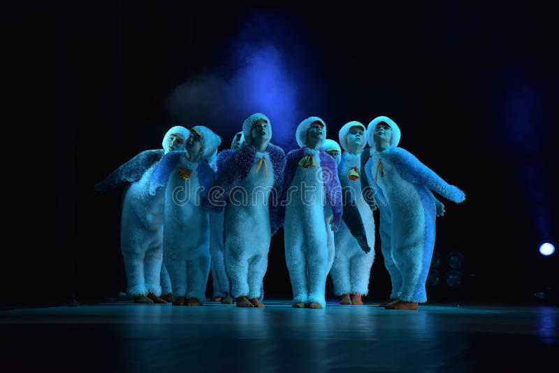 Children in a suit of penguins dance on a stage, Children's danc. E group, Petersburg, Russia stock photos