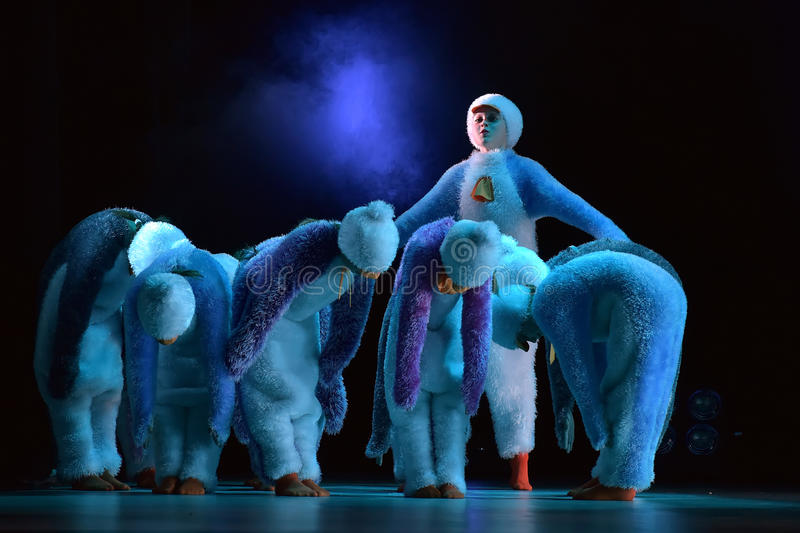 Children in a suit of penguins dance on a stage, Children's danc. E group, Petersburg, Russia stock photo