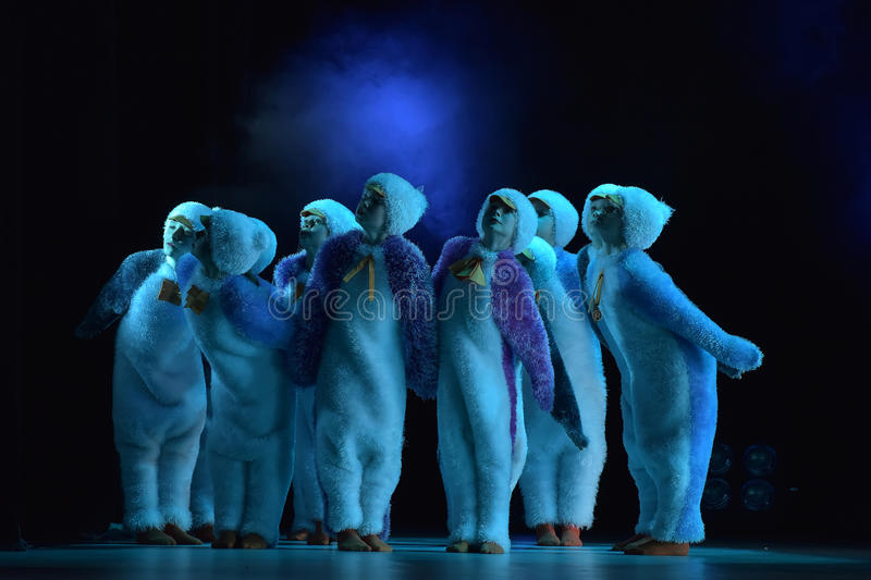 Children in a suit of penguins dance on a stage, Children's danc. E group, Petersburg, Russia stock images