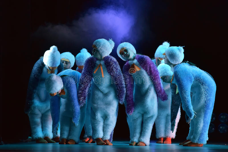 Children in a suit of penguins dance on a stage, Children's danc. E group, Petersburg, Russia royalty free stock photography