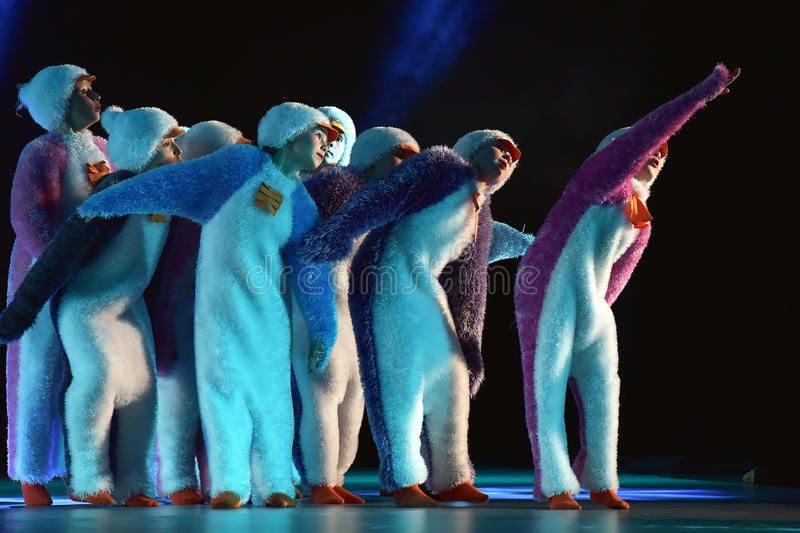 Children in a suit of penguins dance on a stage, Children`s danc. E group, Petersburg, Russia royalty free stock photos