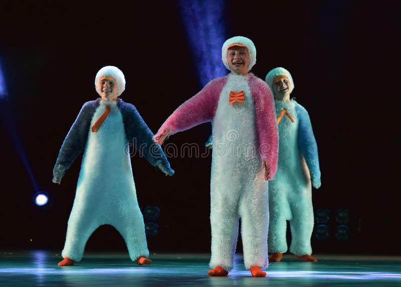 Children in a suit of penguins dance on a stage, Children`s danc. E group, Petersburg, Russia stock photo
