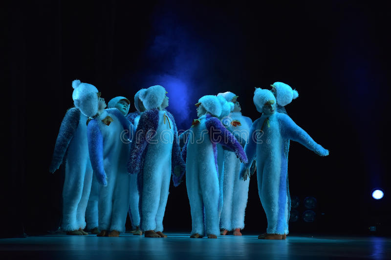 Children in a suit of penguins dance on a stage, Children's danc. E group, Petersburg, Russia stock photography