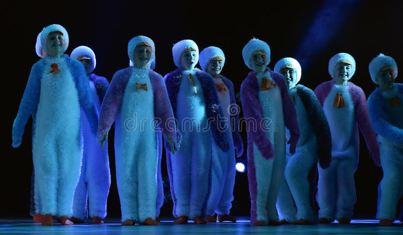 Children in a suit of penguins dance on a stage, Children's danc. E group, Petersburg, Russia royalty free stock photo